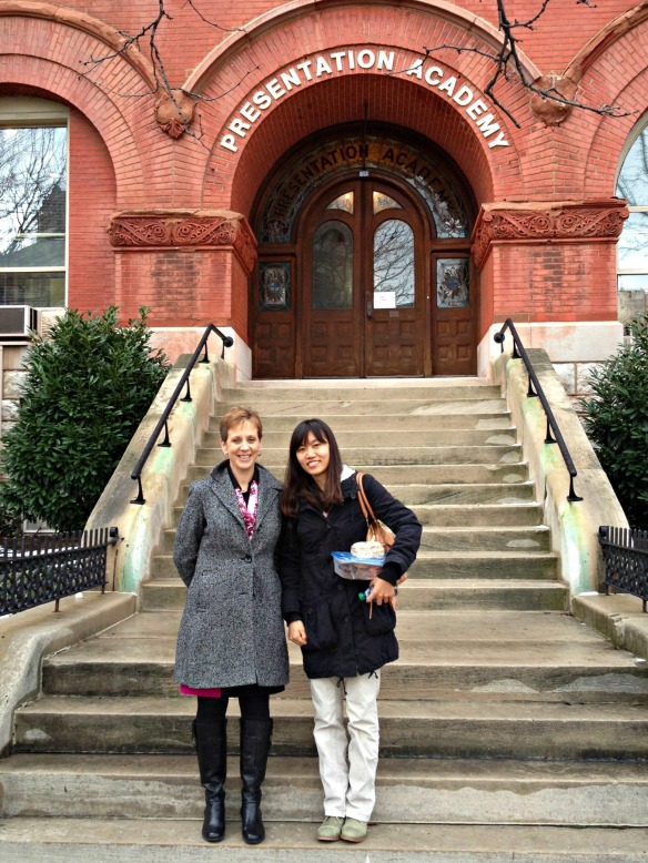 Host teacher Jamie Beach with postdoc Mira Han outside Presentation Academy