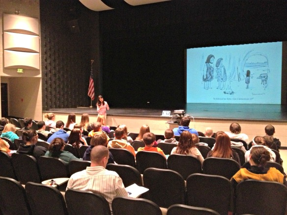 Mira discusses the evolution of dogs with students at Washington High School